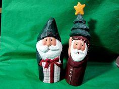 Two Wooden Santa Carving by Eddie Walker