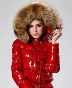 Wow, what a beautiful red puffy jacket, love that fluffy fur hood too!!! #puffyjacket #puffy #red #shiny #nylon #down #puffer #jacket #fluffy #fur #hood #furhood #furfashion #winterfashion
