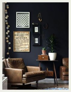 An Indian Summer. Leather chairs and dark charcoal walls.