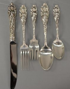 """Reed & Barton """"Love Disarmed"""" sterling silver partial flatware set comprising of 1 dinner fork, 8 luncheon forks, 8 salad forks, 16 teaspoons, 9 tablespoons, and 8 dinner knives, fifty pieces in total."""