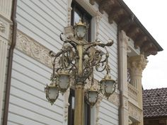 Facade design- detail By Architectural Ornaments Facade Design, Exterior Design, Art And Technology, Historical Architecture, Chandelier, Clock, Ceiling Lights, Ornaments, Detail