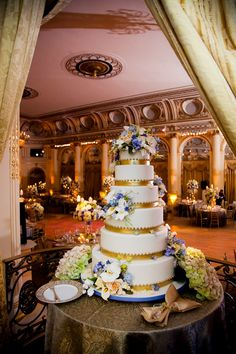 Floral Cake with Blue and Gold Accents | Photography: Images by Berit. Read More: http://www.insideweddings.com/inspiration/board/215/images-by-berit-inc/beautiful-wedding-cakes/