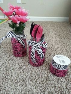 For a zebra print birthday party. Large mason jars wrapped with duct tape and ribbon. Can use for flowers or silverware.