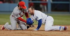 St. Louis Cardinals' Pete Kozma tags out Los Angeles Dodgers' Nick Punto as he is picked off second during the seventh inning of Game 4 of the National League championship series