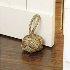 Rope Knot Doorstop - A coastal-inspired design would not be complete without a nautical-inspired rope knot doorstop. It is a functional and fun accent piece.
