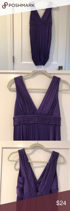 Purple BCBG dress size S/Petite Fun purple BCBG Maxazria petite/small dress was purchased as a bridesmaid dress and has only been worn once. Perfect condition, great details and low cut in the front and the back. It is fully lined in a purple slip underneath.   I am 5 ft 7in and the dress falls about 3 1/2in above the knee. The dress is 96% acetate and 4% spandex. Perfect condition BCBGMaxAzria Dresses