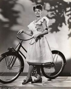 Janet Blair models a bike, ginghamly.Janet Blair Tonight and Every Night Columbia Pictures 1945