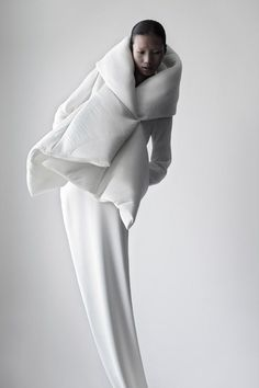 """qiu hao via Trendland.com    """"Don't ask me about inspiration… image is a simple way of saying complicated things."""" These are the first words you read on designer Qiu Hao's site, which, as it turns out is a beautifully stark presentation of the Chinese designer's conceptual clothing line."""