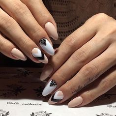 Long nude nails with black and white details - LadyStyle