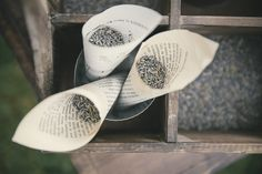 Lavender toss following the wedding ceremony using recycled book pages.  Photo…