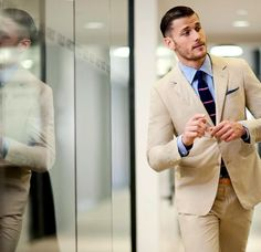 love the suit colour, tie, everything about this outfit