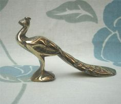 Little Brass Statue He measures four inches in length, and two and a quarter inches high.