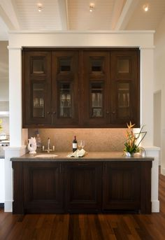 Love the dark stain on the wood.....I'd like my whole kitchen to have cupboards like this!