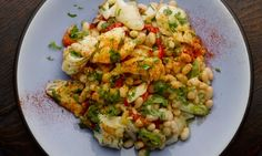 Yotam Ottolenghi's recipes for haricot bean and smoked haddock salad, plus roasted cauliflower and hazelnut salad