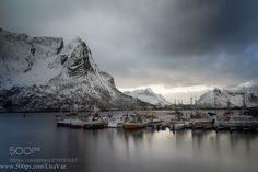 The light of cold by LisaVaz from http://500px.com/photo/210101627 - A long exposure of Reine's fishing port in the evening and the ever changing weather. Lofoten Norway. More on dokonow.com.