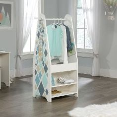 Pinwheel Kids Open Wardrobe in Soft White - Sauder 421886421886 Features: Garment rod for hanging clothesBin for additional storageAdjustable shelf on each sideGraphic end panels feature diamond pattern and decorative knobSoft White Limited M Dress Up Wardrobe, Open Wardrobe, White Wardrobe, Wardrobe Ideas, Hanging Clothes, Closet Shelves, White Houses, Furniture Collection, Adjustable Shelving