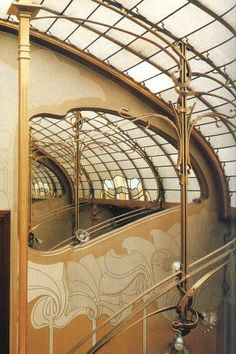 "View across Main Stairs at Upper Landing  Victor Horta House in Brussels, Belgium  Detail showing the art glass laylight and one of a pair of curvaceous mirrors at the top of the home's main stairwell.  Victor Horta designed and built the house and studio for his own family from 1893-97.  Now home of the Musee Horta.  Photo from David Dernie and Alastair Carew-Cox's gorgeous book, ""Victor Horta"", 1995."