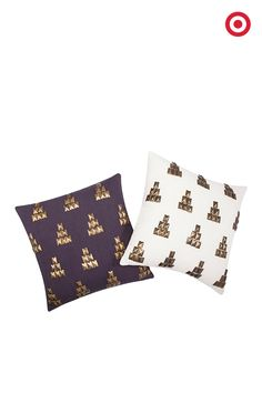Nate Berkus added gold metal studs, arranged in geometric shapes, to his white and navy square throw pillows. Put these on your sofa and give a lustrous lift to the room.