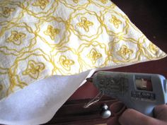 Placemat turned pillow - no sewing required!  I'm sold!