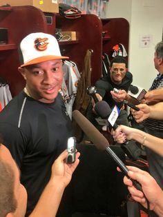 """Manny """"interviewing"""" Schoop, with a bat. Baltimore Orioles Baseball, Captain Hat, Interview, Lol, Hats, Summer, Summer Time, Hat, Hipster Hat"""