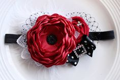 This is a fun piece for Christmas! Rhinestone embellishment may vary from one in photo.  The main flower measures about 3.5 inches.