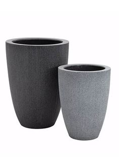 Round High in Dark and Light Grey.   Their resin and glass fibre construction gives them superior strength and resistance to incidental damage, as well as the benefits of light weight.  Radial planters are round in shape, and are distinguished by a fine, vertical ridging. There are light grey and dark grey colours, with light grey only available in certain styles. The colour finish is speckled, adding to the textured look.  These planters seem to sit well in any contemporary garden…