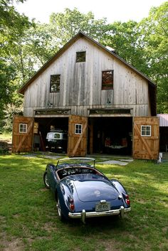 What you want to find in the old Barn you bought ...an MGA and other classic cars.