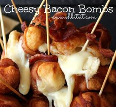 Cheesy Bacon Bombs - 1 can Pillsbury Grands Flaky Layers Biscuits, Cubed Mozzarella, 2 lbs. Bacon (1 slice per Bomb), Sticks, Oil for frying