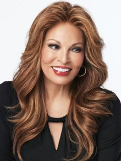 Grand Entrance Human Hair Wig by Raquel Welch. A luxurious long cascading waved layers pure 100% human hair wig that falls to mid-back. A Sheer Indulgence lace front monofilament top provides maximum styling versatility and the ultimate in realism. @$1,274.15