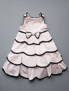 Scallope tiered pink dress by Biscotti in a fine cotton fabric. A great party dress for little girls as well