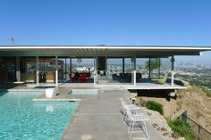 STAHL HOUSE, LOS ANGELES | Dreamed up by Buck Stahl and built by American architect Pierre Koenig in 1960, the floor-to-ceiling glass house was built on a terraced plot of land in the heights in Hollywood Hills. Its cantilevered foundation, popularized by a photo taken by Julius Shulman in 1960, gives the house a dramatic overhang.