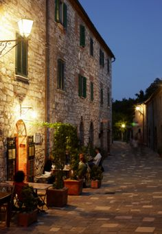 Restaurant with outside dining on a quaint cobbled street in Tuscany,Bagno Vignoni, Italy,