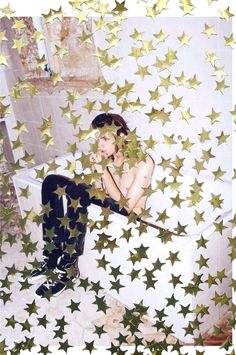 "campaign photo idea / sneak peek ad? can be confetti bits too + stars the idea is like: ""last night was fun, but the party has just begun. find out more on popdropshop.com"""