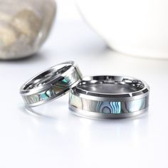 This pair of Abalone Shell Tungsten Couple Wedding Rings are a pair of the most unique wedding rings in the store. They are made of real tungsten carbide and will never fade. The most striking part of the rings are the inlaid abalone shell, which looks like dazzling pool, bright and unique. Matching Wedding Bands, Wedding Ring Bands, Tungsten Carbide Rings, Ring Crafts, Couple Rings, Abalone Shell, Engraved Rings, Anniversary Rings, Promise Rings