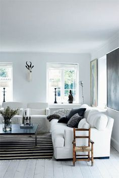 simple. modern | black & white + slipcovers | via Femina magazine