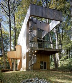 Not a real treehouse...but certainly peaks in the treetops... not sure I could deal with all those stairs!!!  -  archdaily.com