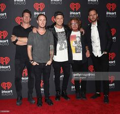 Musicians Zach Filkins, Eddie Fisher, Ryan Tedder, Drew Brown and Brent Kutzle of OneRepublic attend the 2016 iHeartRadio Music Festival Night 1 at T-Mobile Arena on September 23, 2016 in Las Vegas, Nevada.