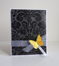handmade card: Colour Splash by Stampin Sue ... black and white with a pop of yellow ... luv the rich black on gray background paper ... die cut butterfly covered in chunky yellow gold glitter ... elegant look ...