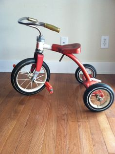 Tricycle. This looks remarkably like one we all rode as children in my parents' home, growing up.