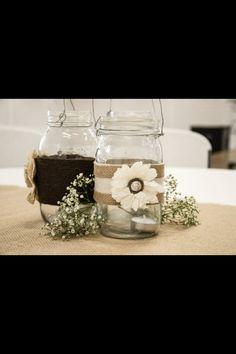 Burlap, mason jars, ribbon Centerpieces
