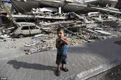 Wreckage: Four-year-old Palestinian Abdel Aziz Jendiyah stands in front of a six-story building, destroyed by an Israeli strike, in the Sabra area of Gaza City this morning  Read more: http://www.dailymail.co.uk/news/article-2711666/Is-Israel-planning-widen-Gaza-offensive-An-extra-16-000-reservists-called-aerial-bombardments-continue.html#ixzz398tijkFP  Follow us: @MailOnline on Twitter | DailyMail on Facebook
