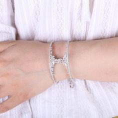 Salma Diamond Bangle Bracelet.Art Deco Cubic Zirconia Cuff Bracelet in Silver or Rose Gold. The Cuff is embellished with Clusters of CZ Diamonds. Adjustable,18k Plated over Brass. Size 5.4cm x 1.8cm. Elegant Women's Jewelry for Weddings, Parties Bridesmaids and Formal Occasions  Handmade Upon Order: Please Allow Approx. Two Weeks Production Time