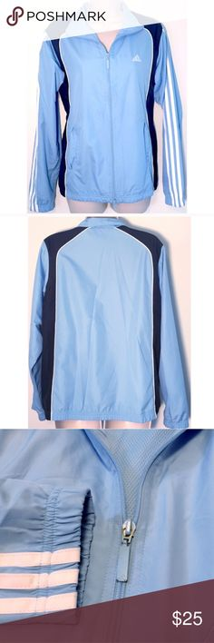 """❣BOGO 1/2 off❣ adidas light blue full zip jacket Windbreaker material. 100% lightweight poly. Navy blue & white secondary colors. Fully mesh lined. Size medium. Measures 25"""" long, 21"""" flat across bust, & 24"""" long sleeves. Excellent condition- only very slight flaw is slight paint gone from zipper, as shown. Otherwise flawless/like-new. ❣Ask me how to get BOGO 1/2 price! ✖️I do NOT MODEL✖️ 🔴Bundle to save! 🔴NO TRADES. 🔴REASONABLE offers welcome via offer button. Smoke-free home. Fast…"""