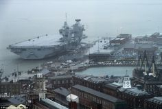 The £3billion and 65,000-tone HMS Queen Elizabeth was photographed in Portsmouth on the da...