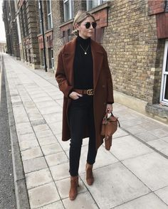 @emmahill: camel H&M wool double-breasted coat, black turtleneck long sleeve shirt, Gucci brown leather belt with double G buckle, blue jeans, tan ankle boots from Top Shop