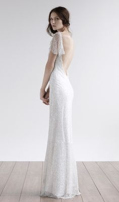 Snowflake  Shimmering mermaid gown with exquisite vintage style cap sleeve, this marvellous beaded and sequin bridal gown with low back has a delicate and glamorous look