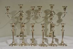 """Candlesticks: 10"""" Tall ; Candelabra: 15 1/2"""" Tall ; Arms : 14 1/2"""" Long. THE 3 LIGHT ARMS OF THE CANDELABRA ARE REMOVABLE FOR A SET OF 8 CANDLESTICKS. 6 FLUTED AND REEDED NEOCLASSICAL CANDLESTICKS ON OVAL REEDED BASES."""