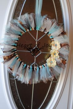 $30.00 Shades of blue, brown and ivory tulle and fabric wreath with ivory flower/blue gem center adornments www.facebook.com/myheartofjoy heartofjoycreations@gmail.com