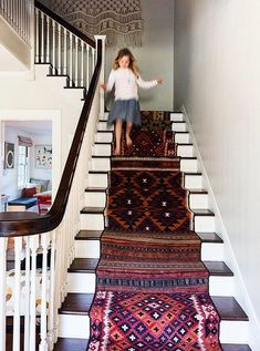 The kilim-covered stairs are the first thing you see when you step inside. Christine sourced the runners online, then with the help of friend Genevieve Carter, a former Commune designer, she cut them up, laid them out to land on a pattern, and worked with Lawrence of La Brea rugs on the install.