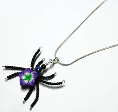 NEW SPIDER DESIGN! $27.99 Aromatherapy Beaded Spider Wire Wrapped Polymer Perfume Pendant. What is a perfume pendant? It is a pendant that defuses perfume while your wear it. Simply put a drop of your favorite perfume in the middle of the flower. The oils will cling to the clay petals and will emit scent, longer than wearing it on your skin. You can wear perfume and perfume oils on this pendant. You can wash the pendant with soap and water to change the perfume you want to wear on it.
